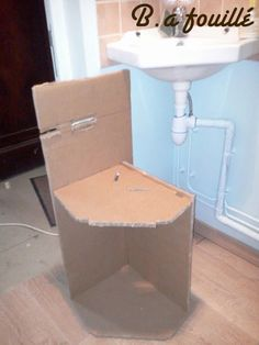 Upcycled Cardboard around a Siphon as Bathroom Furniture Recycled Cardboard Cardboard Storage, Cardboard Furniture, Recycled Furniture, Diy Furniture Nightstand, Bathroom Furniture, Bathroom Mixer Taps, Bathroom Fixtures, Modern Master Bathroom, Small Bathroom