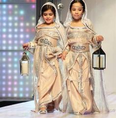 Little girls in a traditional Moroccan clothing fashion show pinned from المغرب Morocco