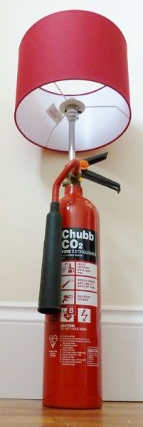 Stunning lamp utilising a Chubb CO2 fire extinguisher as the base. Also available as a full height standard lamp. Ideal for use as either a floor or table lamp. Red painted aluminium extinguisher, chromed copper upright with steel core and chrome BC switched lampholder complete with shade ring. Supplied with 2m of black plastic flex and black mains plug. Max bulb 100w. £95.99