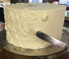 Rustic Frosting | When I use this technique I start out with a smooth frosted base. this is more than a crumb coat, you need to really even out your cake. Once it is frosted and chilled I take out the layers one at a time starting with the base. That way they remain chilled and firm as I spackle on more frosting! I just pipe simple dots 3 at a time up the cake- then use my little spatula to spread them, they will set up quickly. C shaped swirls in two different directions.