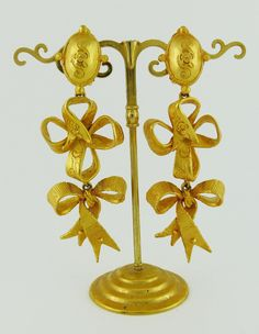 View this item and discover similar for sale at - CHRISTIAN LACROIX vintage gold toned dangling earrings (clip-on) featuring a gorgeous ribbon design with textures and stylized flowers details. Bird Jewelry, Metal Jewelry, Chandelier Earrings, Dangle Earrings, Ribbon Design, Silver Spoons, Christian Lacroix, Vintage Jewellery, Ysl