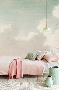 Who wouldn't want to wake up to clouds on the walls? Love this soft and serene bedroom palette.