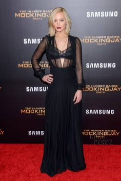 Jennifer Lawrence Is A Bourbon-Swilling Seductress In A Sheer Lace Top At Hunger Games New York Premiere