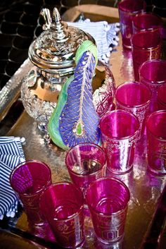Moroccan tea with hot pink Moroccan glasses at Peacock Pavilions design hotel in Marrakech Morocco.  Styling: M. Montague