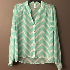Xhilaration Chevron Button Down Blouse Trendy chevron sheer top with gold button accents. Front length: 22 inches ; Back length: 25 1/2 inches. Size MEDIUM on tag but runs a little small. Pre- loved and no defects. 100% Polyester {Negotiable}. Xhilaration Tops Button Down Shirts