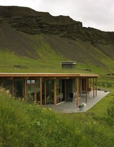 An amazing mountainside grass roof home with a well-designed contemporary interior
