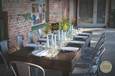 Rustic farm tables at outside Durham wedding venue Belt Line Station!  Flowers by raleigh wedding florist Flair! by Triangle Catering #TriangleFlair #NextStopDurham #TriangleWeddings (photo courtesy of Libby McGowan Photography)