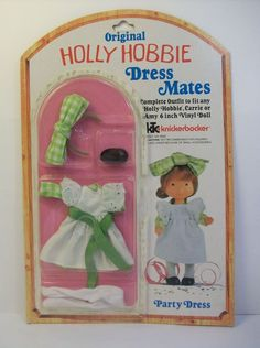"Holly Hobbie Dress Mates Party Dress Outfit. This outfit is for the 6"" plastic vinyl dolls Holly Hobbie, Carrie or Amy. Although this outfit is new, the edge of the plastic over the clothes has become loose about 2/3 around the plastic. 