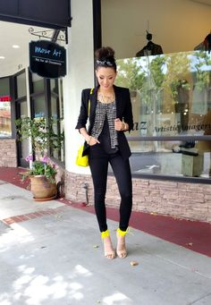 Pop of yellow with black blazer, skinny jeans and black and white blouse