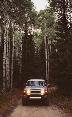 Toyota FJ Cruiser in the mountains among-st trees. Park City Utah.