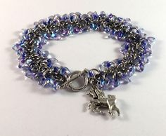 Excited to share the latest addition to my shop: Beaded chainmaille bracelet - Shaggy bracelet in purple lined crystal - unicorn charm bracelet Purple Line, Chainmaille Bracelet, Perfect Mother's Day Gift, Celtic Art, Stainless Steel Rings, Sea Glass Jewelry, Organza Bags, Shaggy, Silver Bracelets