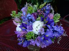 sympathy flower arrangement blue & purple 13   Blue and Purple Flowers Convey Cool Elegance in This Wedding Bouquet.