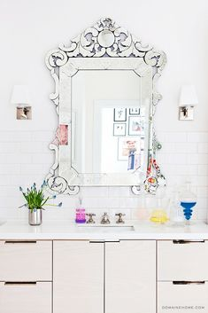 Home Tour: A Legendary New York Townhouse via @domainehome // venetian mirror, vanity