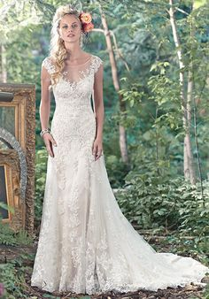 A-line slip dress with stunning illusion back and sweetheart neckline, edged in floral lace appliqués | Maggie Sottero | https://www.theknot.com/fashion/tami-maggie-sottero-wedding-dress