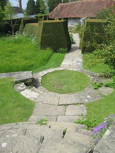 Small round lawn as pivot between paths and meadow and mown grass adds 'formality'    (Great Dixter - E.L. Lutyens, Architect).