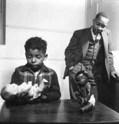 THE CLARK DOLL EXPERIMENT (1939) - Test was done by Dr. Kenneth Clark & his wife Mamie (The black child chose the white doll because from birth he was taught that white is better.)