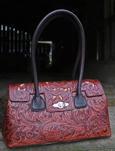 A Cowgirl's Promise LLC Store - Juan Antonio Saddle Brown Tooled Leather Handbag Purse, $535.00 (http://www.acowgirlspromise.com/juan-antonio-saddle-brown-tooled-leather-handbag-purse/)