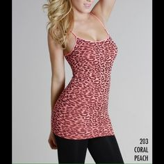 Leopard Print Tunic Length Tank in Peach Extremely comfortable and soft tunic length tank top in a beautiful and trendy animal print.  Perfect under a sheer chiffon blouse or  alone.  The long length is very alluring.  Stays put without rolling up.  This will be your favorite must have item.  NS5175 Niki biki Tops Tank Tops