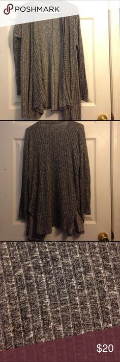 Black American eagle cardigan Cute cardigan but unfortunately it's a bit long for my taste. Worn a couple of times but in great condition. No snags. Size M American Eagle Outfitters Jackets & Coats