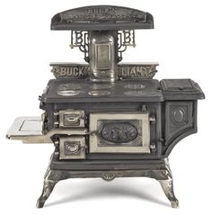 Buck's Stove & Range Co. cast iron and nickel Buck's Brilliant toy stove, 19'' h., 19'' w.