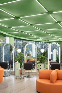 Tangerine-coloured soft furnishings and pale-green Italian storage units, combined with chrome finishes and strip lighting, continue the space age theme while giving it a more modern Italian feel. Curved Reception Desk, Barbershop Design, Curved Walls, Glass Facades, Treatment Rooms, Create Space, Space Age, Ceiling Design, Retail Design