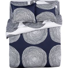This is the duvet set we bought for our bedroom. Wanting to incorporate some natural woods, yellow, maybe gold. How can I warm this up? Marimekko Pippurikera Navy Bed Linens in All Decorative Bedding | Crate and Barrel
