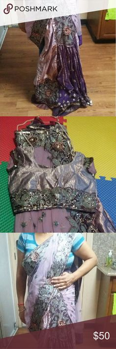 Indian sari Nice ready to ware chanya choli Style sari. 1 time wear ,  the color is purple silver and green on the bottom net sari Other