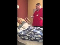Hospice worker sings for patient