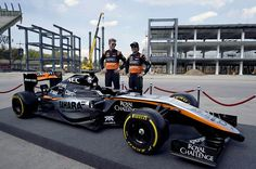 Force India drivers Mexican Sergio Perez (R) and his teammate German Nico Hülkenberg (L) pose next to a Force India Formula 1 Team car with the new team livery that will adorn their cars, during a tour for the media on January 22, 2014, at the premises of the Autodromo Hermanos Rodriguez racetrack in Mexico City which is being remodelled for the November 1st, 2015 FIA One World Championship.