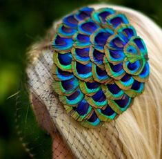 There are so many ways to use Peacock #feathers on your #wedding day! We love this veil, click through for more ideas.