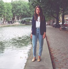 Heloise, one of our French employee and model, is wearing the High Waist Jean in Medium Wash Indigo and the Women's Blazer in Navy by #AmericanApparel.