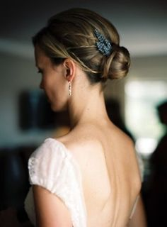 Simple, cute bun with blue hair accessory: #weddinghair #weddingdress #bun: http://kantzos.com/