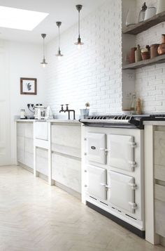 I love the Aga stove in the first image. When renovating our current home this kitchen stove did not fit into our budget but an Aga is is still on my wish list for a future home. Aga Stove, Kitchen Stove, New Kitchen, Kitchen Dining, Kitchen White, Kitchen Ideas, Country Kitchen, Kitchen Brick, Neutral Kitchen