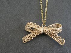 Gold Lace Bow Pendant Necklace, Birthday gift, Gift for Friend, Bridesmaid gift, Sister Gift. $24.00, via Etsy.