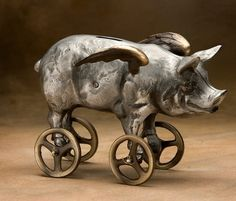 "piggy bank from Nelles: ""sand-cast bronze and aluminum coin bank, in the form of a flying pig with wheels."""