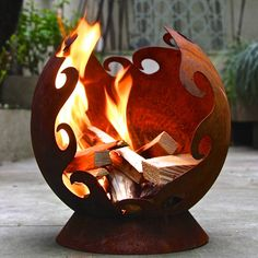 Our stunning mini firepit is perfect for the smaller outdoor space and city living. Perfect for camping and easy to move around before lighting.For those of us who think their garden is too small for a traditional firepit, our lovely little mini flames firepit has come to the rescue. For all you city dwellers with tiny yards or gardens, our firepit will do the job nicely. With its rusty iron finish and swirl detailing look its very decorative even when not lit and could also be used as a…