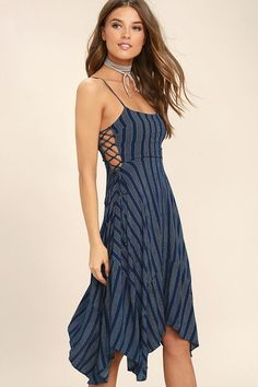 Take on a tranquil temperament the moment you slip into the At Ease Navy Blue Striped Lace-Up Midi Dress! Woven fabric, with a dotted, stripe print, falls from adjustable straps into a darted bodice with lace-up sides. Fitted waist transitions into a flaring midi skirt with a handkerchief hem. Hidden back zipper.