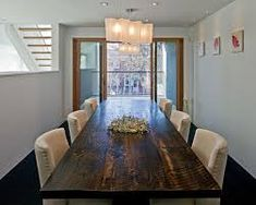 Diy dining table ideas dining room contemporary with dark floor sliding glass doors dining table centerpiece Narrow Dining Room Table, Door Dining Table, Rustic Dining Room Sets, Pub Table And Chairs, Dining Room Furniture Sets, Reclaimed Wood Dining Table, Wooden Dining Tables, Pub Tables, Bedside Tables