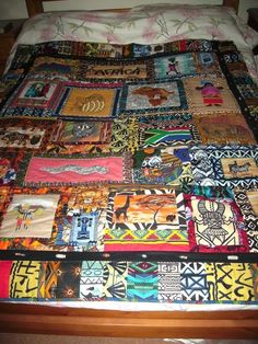African quilt This quilt is nice.  African fabric pieced together in random squares and fussy cut pieces, then sewn in strips.