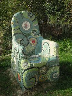 metal chair covered with chicken wire, concrete, & mosaic