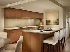 Contemporary kitchen in an ivory palette, with sleek wood cabinets. Rustic Kitchen, Kitchen Decor, Kitchen Ideas, Micro Kitchen, Contemporary Kitchen Cabinets, Inside Home, Kitchen Cabinet Design, Home Kitchens, Dream Kitchens
