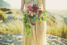 gold sarah seven wedding dress and bouquet