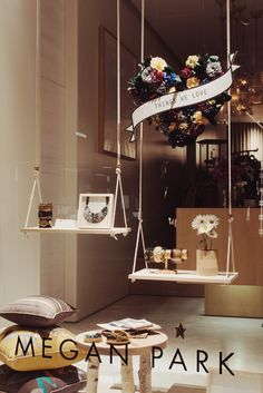 great window display idea, recycle and paint up an old wooden swing