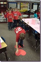 Heart Lava game...move across the room by stepping on two hearts (fun for a classroom party)
