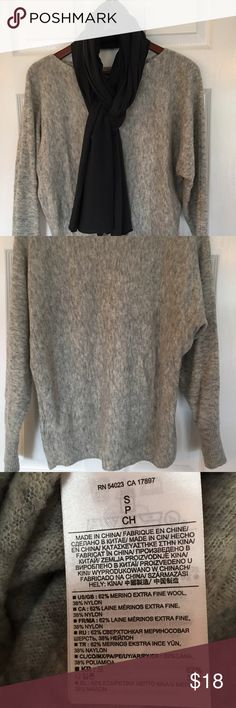 Light Gray Wool Sweater Super soft wool sweater with the Dolman sleeve. Perfect condition. This weather looks great layered over a turtleneck or a long sleeve T-shirt. The loose fitting waste makes it great to pair with a pencil skirt. No brand tag. I feel like the sweater could also fit a medium. Sweaters Crew & Scoop Necks