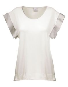 Shimmering satin inserts on the sleeves and side sections lend this top cool chic and elegance. Casual cut with attractively shaped neckline and dropped shoulders.