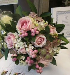 Mixed handtied bouquet of roses, snowberries and bouvardia