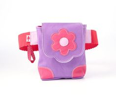 Wild Flower! #Inspire your little #girl (ages 4+) to always follow her heart and help promote independence with our fashionable & fun hands-free #bags! She'll love all the different ways to wear it: Style it around her waist, on her hips, bag in front or on the side!  Visit our page to see why this little #purse makes a great #gift! $29.99