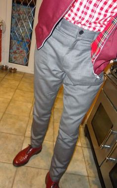 Looking sharp in Sta-Prest trousers with red gingham shirt and burgandy harrington jacket.