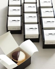 black and white favor boxes with mini black and white cookies tucked inside